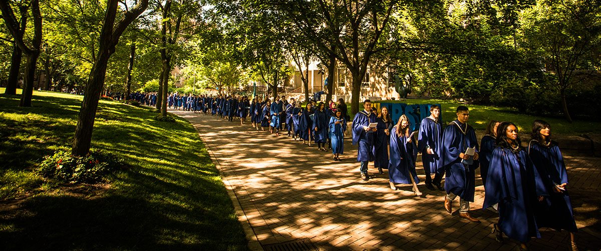 Ryerson graduates walking along path
