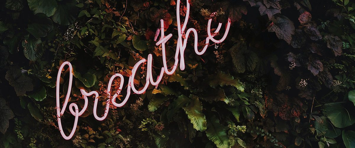 Neon lights that read 'breathe'